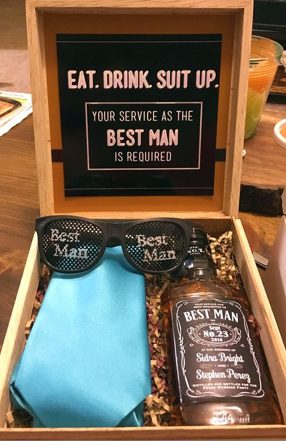 a box with whiskey, a bold tie to wear on the big day and sunglasses