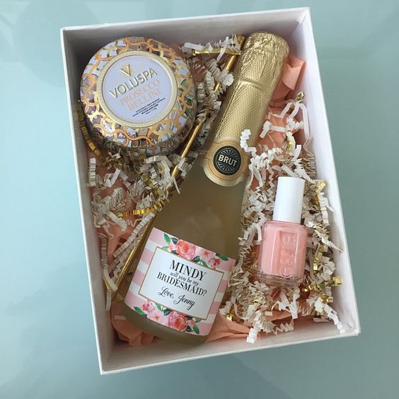 a cute box with pink nail polish, a bottle of brut and a spa candle is great for asking the question