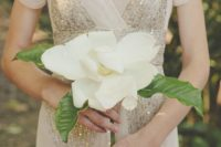18 a large magnolia and some foliage is a nice idea for a single stem wedding bouquet