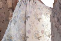 18 a plunging neckline wedding dress with thick straps and blue embroidered flowers