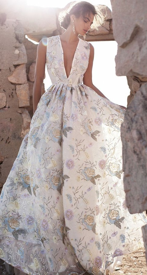 a plunging neckline wedding dress with thick straps and blue embroidered flowers