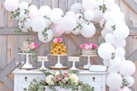 18 a white balloon and eucalyptus garland for making a dessert table backdrop