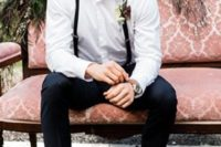 18 black pants, a white shirt, black narrow suspenders, amber shoes and a boutonniere