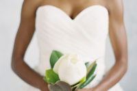 19 a single closed magnolia is another chic idea for a single stem bouquet, it's large enough and looks chic