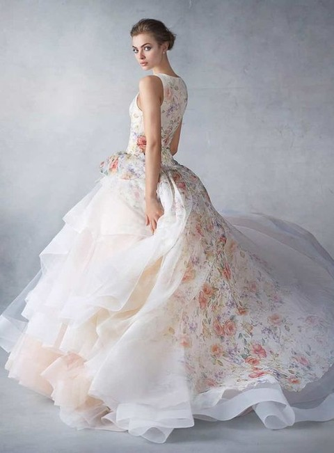 a sleeveless floral print wedding dress with a layered ruffled skirt and a train