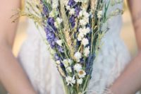 20 a cool rustic bouquet with wheat, purple delphinium, some dried white blooms