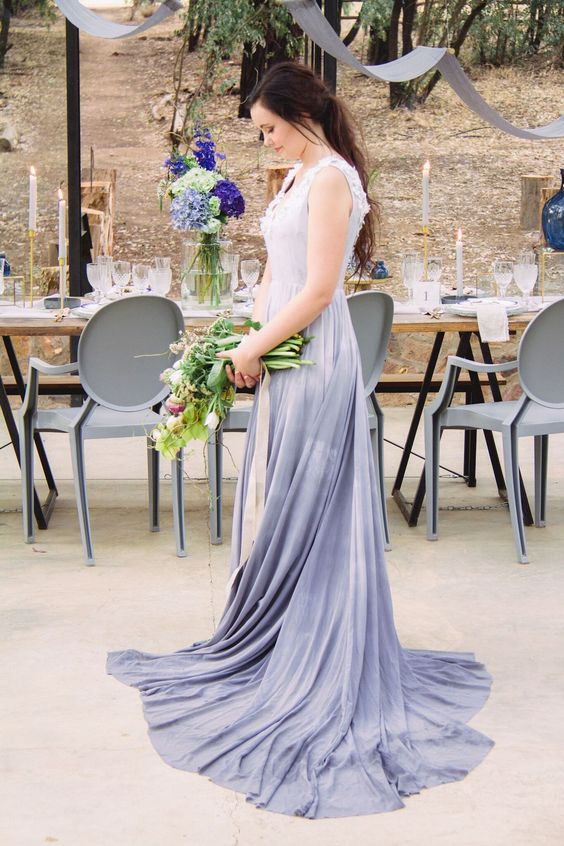 a sleeveless lace applique wedding dress with a V-neckline and a slate grey ombre skirt