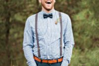 20 dark teal pants, a blue printed shirt, a black bow tie, brown suspenders and an amber leather belt ffor a stylish and simple look