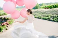 20 pink balloons instead of a usual wedding bouquet look super cool and fun
