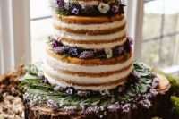 21 a naked wedding cake with fresh flowers and herbs for a woodland feel