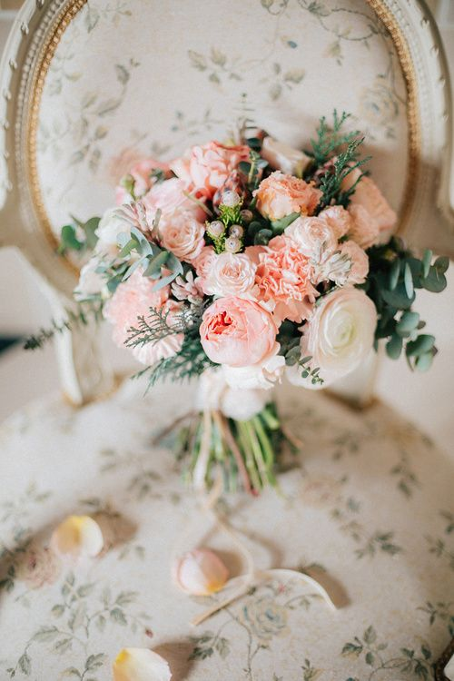 a pink and white wedding bouquet with eucalyptus and other greenery for a romantic bride
