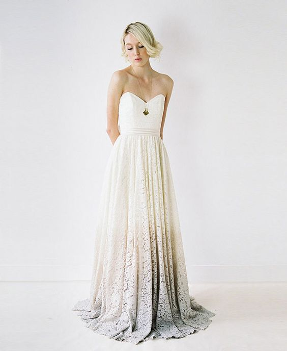 a strapless sweetheart neckline A-line wedding dress with an ombre grey lace skirt