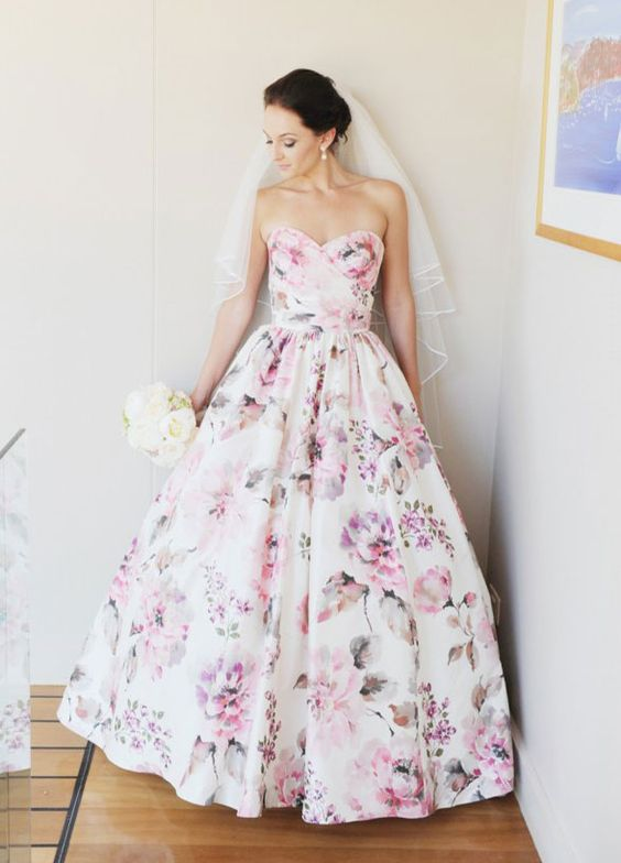 a strapless sweetheart neckline wedding dress with pink floral prints for a cool bridal look