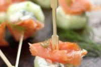 21 fresh cucumber slice plus cream cheese and salmon is a tasty appetizer idea for any season
