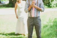 21 grey pants, a light grey shirt, a pink tie, thin leather suspenders and cognac shoes for a rustic backyard celebration