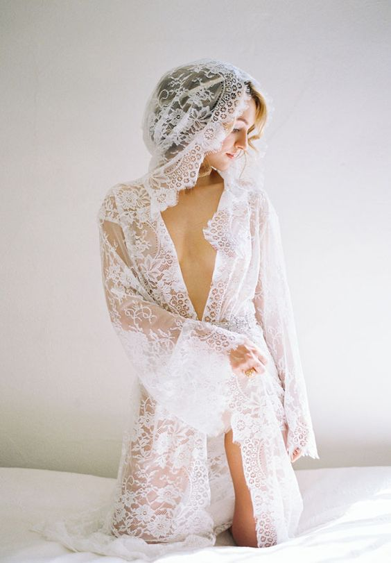 a long Chantilly lace bridal robe with long bell sleeves and a hood looks creative and sexy