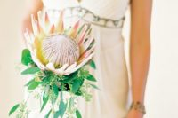 22 a single stem king protea bouquet with eucalyptus looks chic and gorgeous