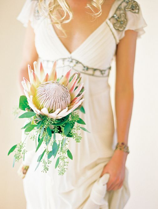 a single stem king protea bouquet with eucalyptus looks chic and gorgeous