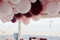 22 a wedding lounge with a gorgeous balloon chandelier over it