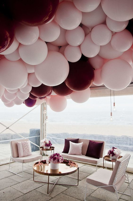 a wedding lounge with a gorgeous balloon chandelier over it