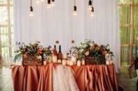 22 a white curtain backdrop, overhead blooms and bulbs for a fall wedding