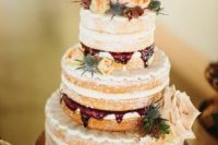 23 a naked wedding cake with raspberry mousse inside, blush, cream and orange blooms and thistles