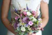 23 a small ball-like bouquet with pink, mauve, purple, white blooms and greenery for a textural look
