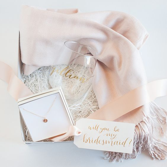 a stylish box with a wine tumbler, a scarf, a necklace to wear on the wedding day