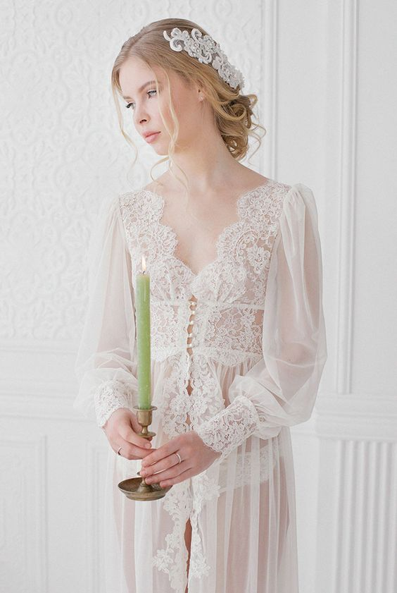a vintage-inspired off-white bridal robe with a lace bodice, lace trim and sleeves and puff sleeves