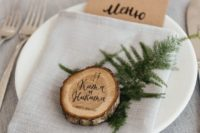 23 a wood slice coaster and place card in one is a simple and cute idea