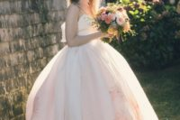 23 spaghetti strap wedding ballgown with a large bow on the back and floral prints on the skirt