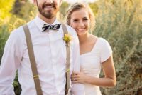 23 tan pants and suspenders, a white shirt, a striped bow tie and a bold yellow boutonniere for a relaxed look