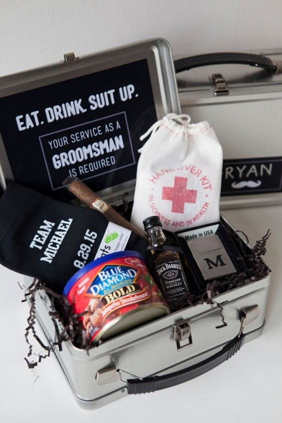 a metal suitcase with a hangover kit, a lighter, a cigar, socks, Jack Daniel's and almonds as a snack
