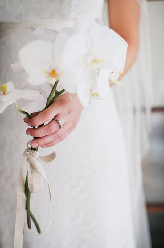 a single stem white orchid is a gorgeous refined choice for a wedidng bouquet