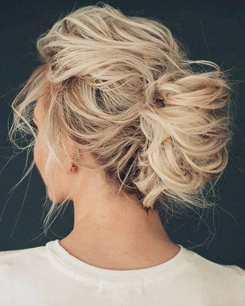 a very messy updo with twists and locks down for short hair looks very chic