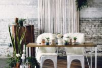24 a white fringe backdrop  with lush foliage for a boho-inspired wedding
