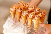 24 spicy tuna served in wonton ice cream cones with toasted black sesame seeds is a creative idea