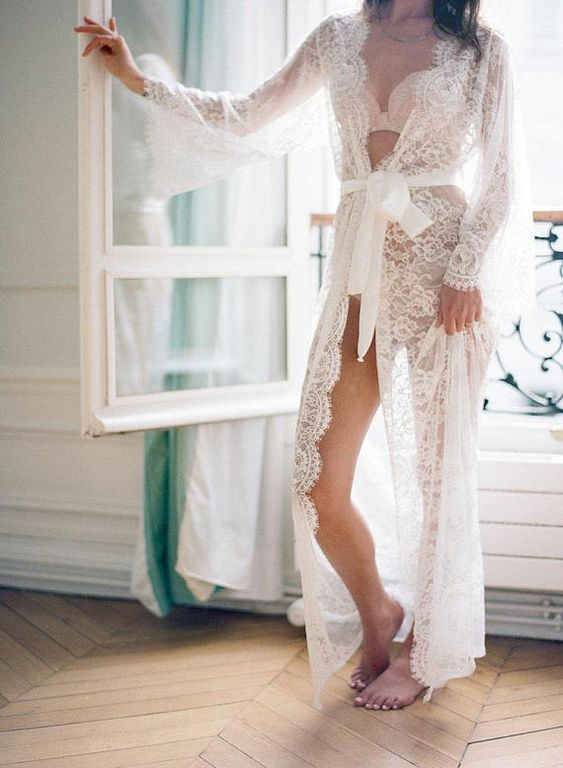 a refined long white lace bridal robe with long sleeves and chic lingerie to show off to impress him