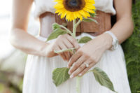 25 a single sunflower is a great choice for a rustic or farmhouse bride