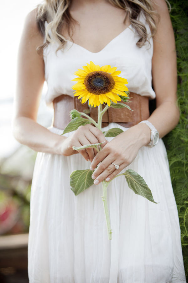 a single sunflower is a great choice for a rustic or farmhouse bride