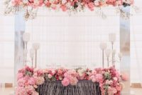 25 an airy fabric backdrop completed with lush florals that match the table runner