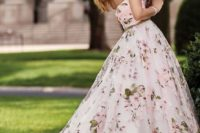 25 strapless sweetheart neckline ballgown with pink floral prints and a green sash that matches the prints