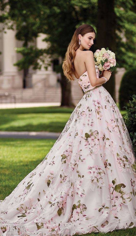 strapless sweetheart neckline ballgown with pink floral prints and a green sash that matches the prints