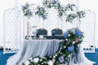 26 a cool folding screen with lilac, blush and blue blooms and greenery