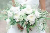 26 a large elegant white peony and greenery bouquet for a bride who loves classics
