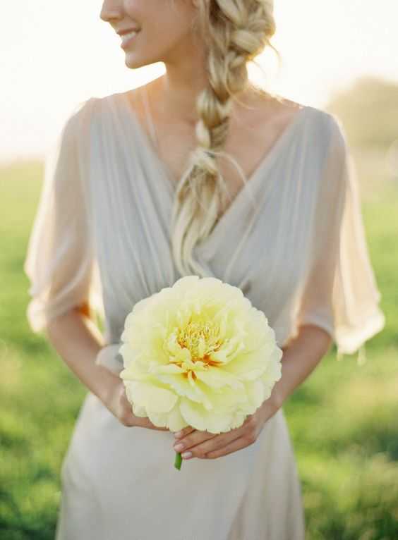 a single yellow bloom that stands out with a dove grey bridesmaid's dress