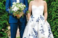 26 strapless sweetheart neckline wedding dress with a high low skirt and blue floral prints all over the skirt for something blue