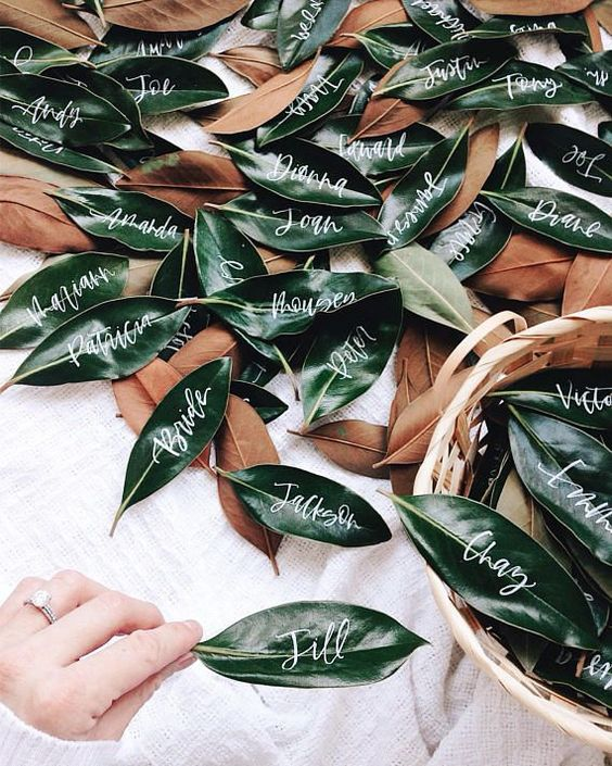 magnolia leaves with calligraphy to use them as place or escort cards