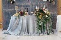 28 an aged metal backdrop with geometric pieces, blooms and herbs for a bold look