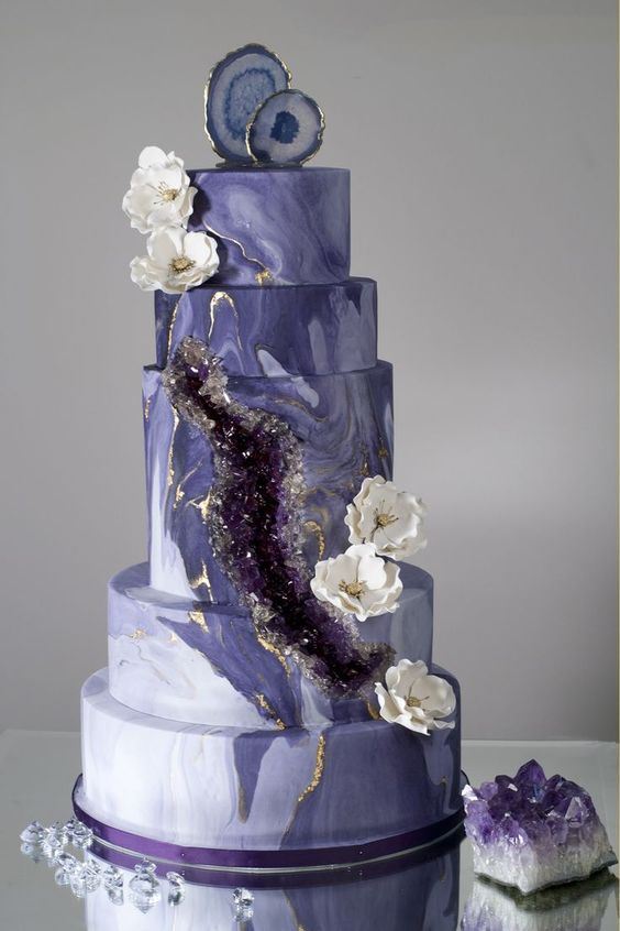 marbleized purple wedding cake with amethyst decor, gold leaf and some geode slices on top